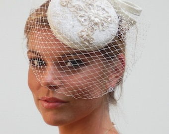 dutch design bridal piece with sinamay and lace on aliceband birdcage veiling included but optional