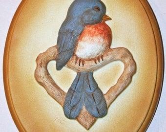 Bluebird on heart shaped branch plaque
