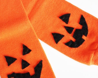 orange jack-o-lantern baby leg warmers - orange with pumpkin face