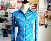 1970s Futuristic bright blue long sleeved blouse