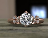 Pink petal engagement ring with diamonds