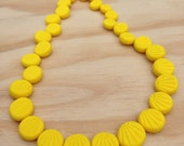 Fossil Necklace: shell like relief pattern in every handmade bead.