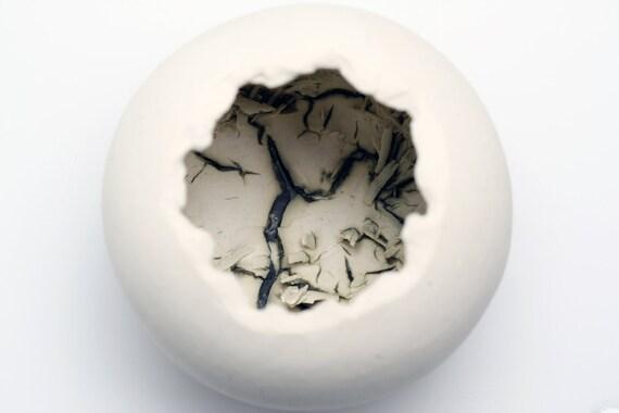 Stoneware decorative sphere vessel with white clay & copper oxide.