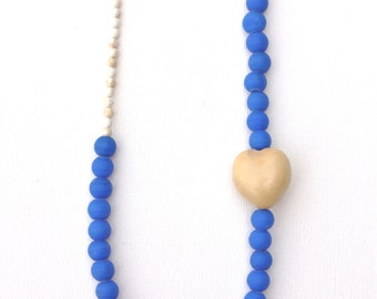 Royal blue necklace with cream gemstones and heart-shaped bead