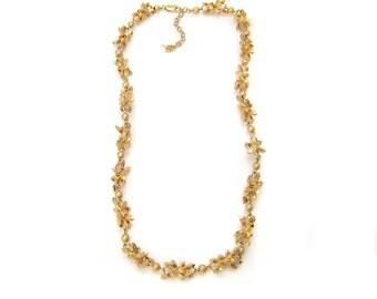 "Long golden necklace ""Faggots crystallized"""