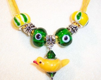 U of O Duck Necklace with Glass Yellow Duck and European Murano Glass Beads on Voile Ribbon