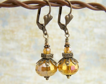 Honey Amber Drop Earrings with an Oriental flair - antique brass and amber crystal beads