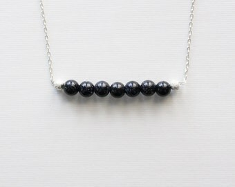 Clear Night Skies Necklace --- a row of seven sparking purple goldstone beads