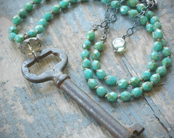 mint green knotted vintage steel skeleton key necklace with czech glass, silk & oxidized sterling silver by val b. adjustable.