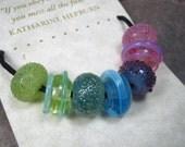 rainbow jewels (7) lampwork glass beads