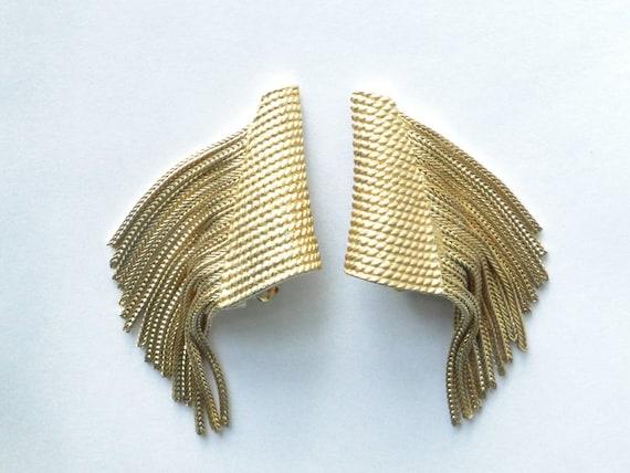 Hattie Carnegie fringe earrings. Vintage gold toned clips. Signed
