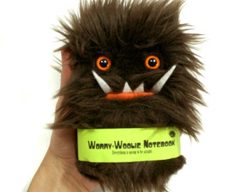 Worry-Woolie monster notebook in brown and blue, a magical pocket journal