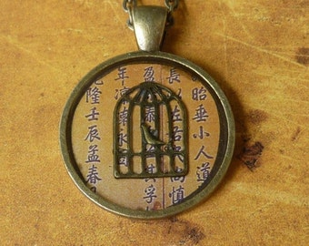 Asian birdcage necklace