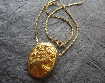 Vintage Goldtone Woman Figural Cameo Oval Pendant  on a 16 inch Chain