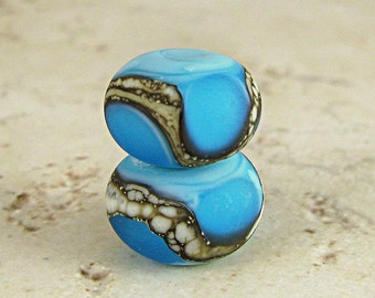Blue Glass Lampwork Bead Pair with Organic Silvered Ivory Web and Frosted Finish Small 11x7mm Aqua on Turquoise Velvet