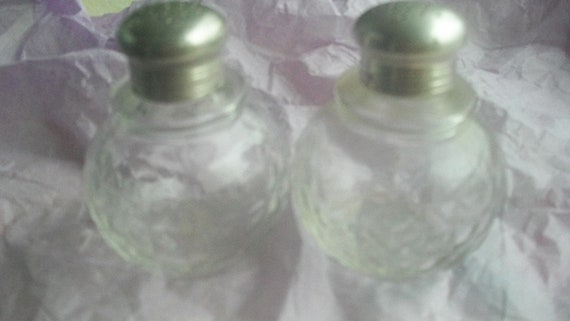 vintage salt and peppers with silver tops- TAKE 50% off