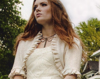 As seen is Oregon Bride Magazine Made to Order Ivory Wool Bridal Shrug with Ruffle Edge and Flowerette