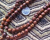 108 bead wood skull bead mala 7x8mm