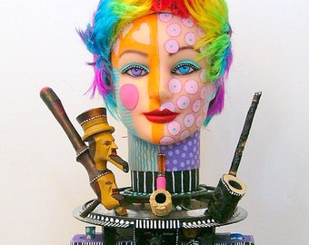 What The Hell Was She Smoking  recycled found object sculpture SHE IS PUBLISHED