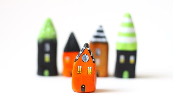 Halloween little house - orange and black clay house with white stripes and tiny ghost in the window