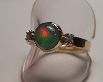 Ethiopian Opal and Diamond ring  14 kt Gold  ....... size 7 ............    e353