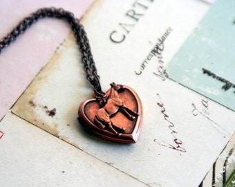 horse. locket necklace. copper ox
