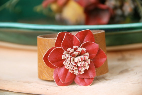 Amber. burnt red, floral,brown leather cuff. Tiedupmemories