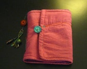 Quilted handbound cloth book in purple teal & fuschia