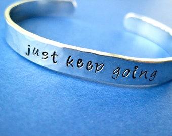 Hand stamped Bracelet - just keep going - motivational bracelet - Hammered aluminum metal finish - Skinny 1/4 inch