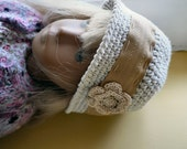 Beautiful cloche hat in a cream organic cotton yarn to fit a Sasha Morgenthaler doll