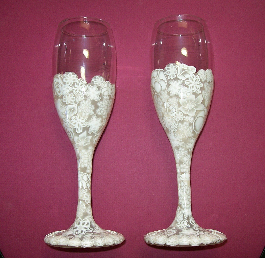Pair of champagne flutes or wine glasses in white on white - Fluted wine glasses ...