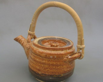 Lovely tan teapot with a bamboo handle