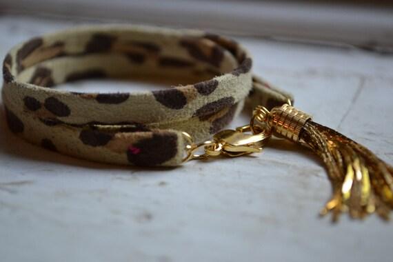 neutral leopard print genuine suede triple wrap bracelet with gold tassel