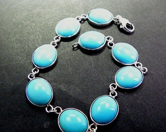 AAAA Sleeping Beauty Turquoise Bracelet 14K white gold Bracelet  7 inches w/ 9 - 12x10mm cabochons. Approx. 36 carats TW MMM