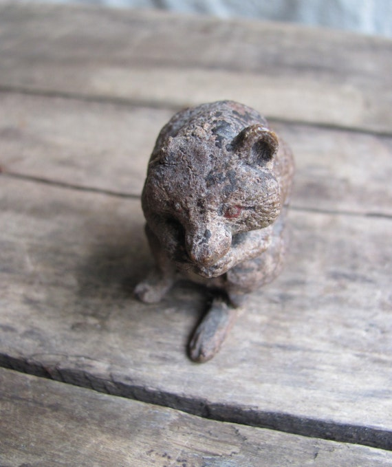 SALE // antique rabid raccoon figurine with beady red eyes