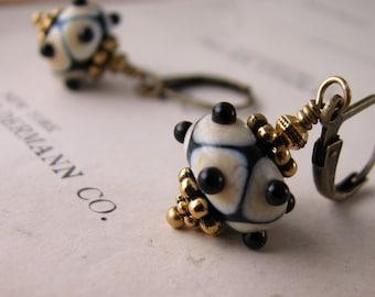 Black and white tribal lampwork glass earrings