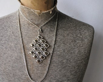 Luxurious vintage 70s silvertone metal necklace with chunky geometric style pendant. Made by Whiting and Davis.