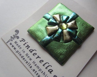 Holiday Birthday Christmas present pin wrapped in chartreuse green with bow brooch