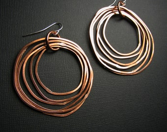 Copper Hoop Earrings -  Shiny finish - Seven Layered rings - light weight - handmade