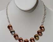 Gliese, handmade, sterling silver, copper and brass, concave, 14mm disc, contemporary necklace