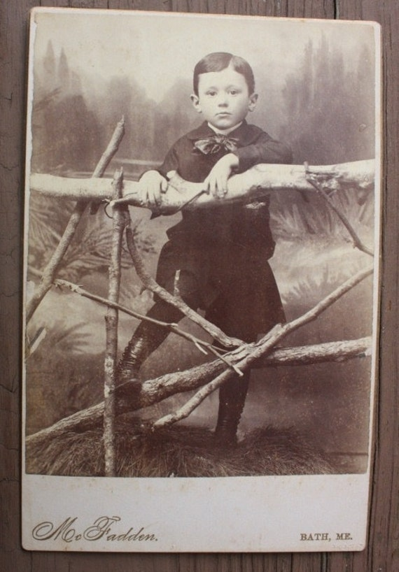 Cabinet card of a little boy ready to explore the world
