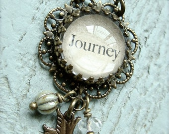 Journey.  Antique brass charm necklace with domed glass pendant.  Jewelry by Sweet And Simple.