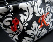 Monogrammed Waterproof Cosmetic Case - Black Damask with Orange Accents (free monogrammed initial)