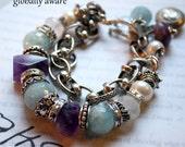 SHOP SALE globally aware aquamarine amethyst charm bracelet