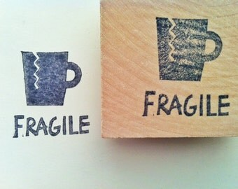 fragile stamp. brocken cup hand carved rubber stamp. snail mail packaging stamp. breakable fragile sign. office stationery. mounted