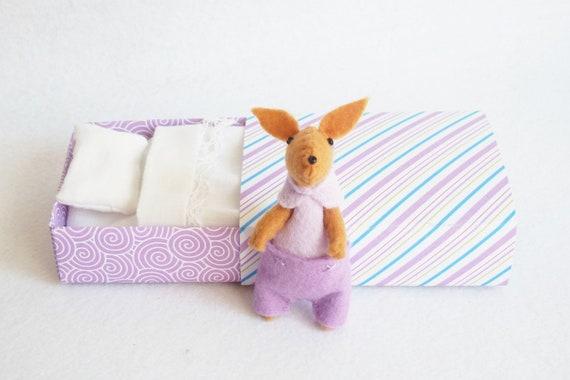 Lilac felt bunny in matchbox bed