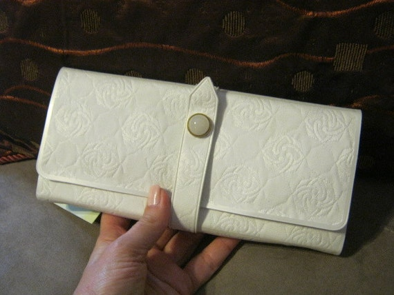 Never used white quilted faux leather fabric look jewelry travel case clutch