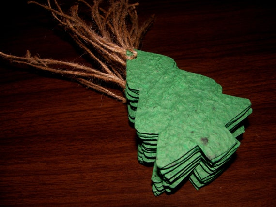 Christmas Gift Tags Made of Green Plantable Paper in Christmas Tree Shapes