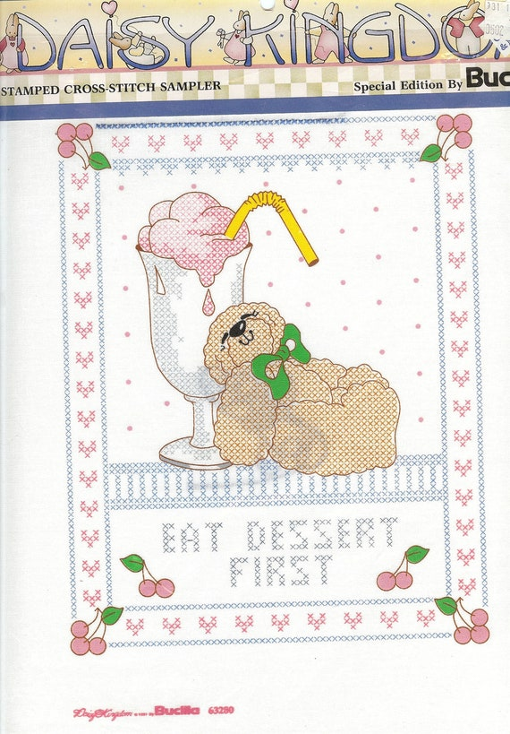 Daisy Kingdom Bucilla Stamped Cross Stitch Kit 63280, Eat Dessert First, about 10 by 12 inches
