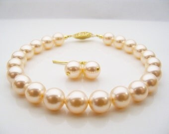 Pearl bracelet Swarovski pearl bracelet 8mm round Peach pearls and gold plated filigree clasp